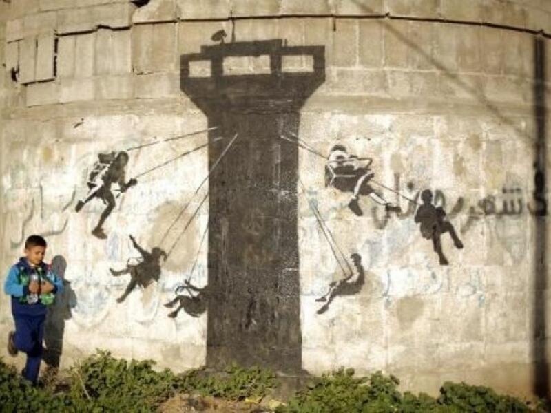 Banksy - Palestyna - wieża karuzela