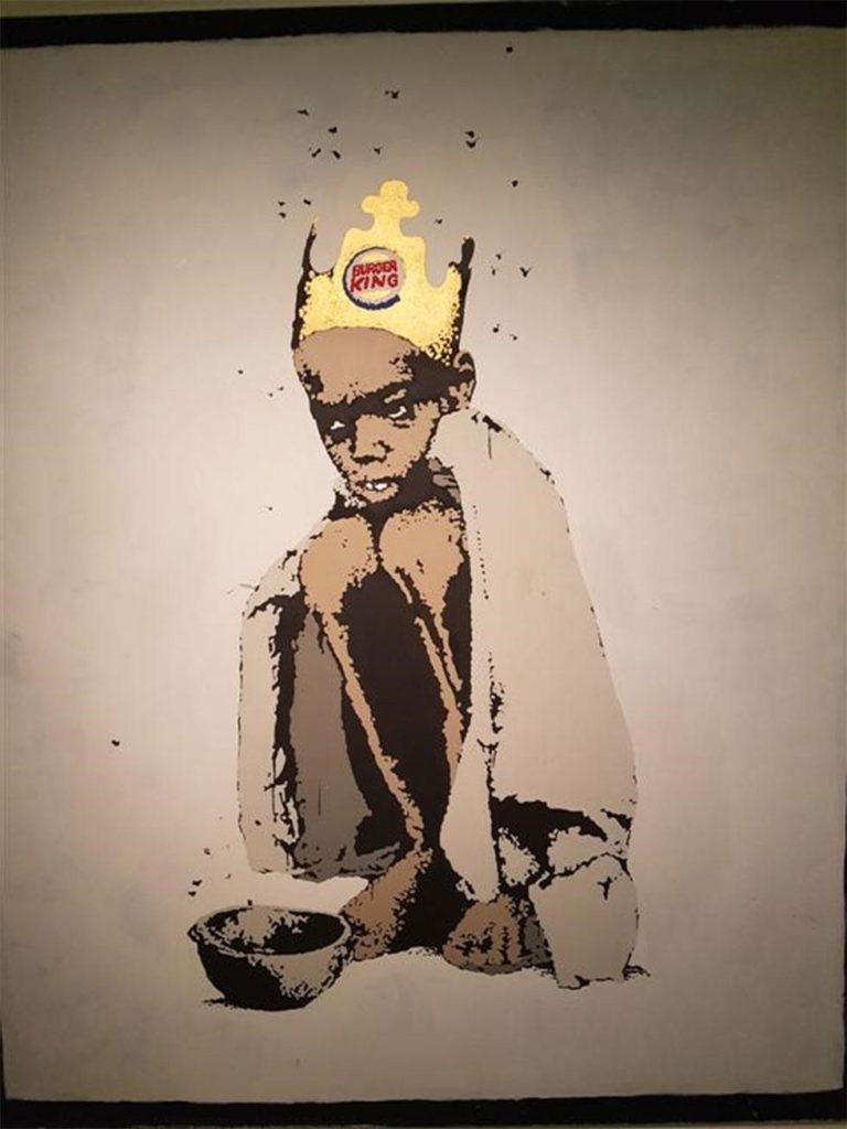 wygłodzone afrykańskie dziecko w koronie Burger King